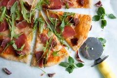 Pizza with tomato sauce, prosciutto and arugula. Perfect healthy lunch idea: Pizza with tomato sauce, prosciutto and arugula royalty free stock images
