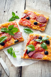 Pizza with tomatoes, cheese and salami Stock Photography