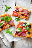 Pizza with tomatoes, cheese and salami Stock Image