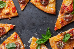 Pizza with tomatoes, mozzarella and basil Royalty Free Stock Image