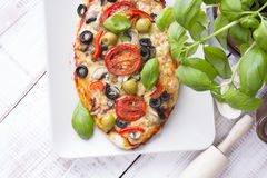 Pizza with tomatoes, mushrooms, olives and peppers Stock Photography