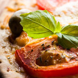Pizza with tomatoes Royalty Free Stock Images