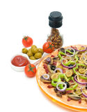 Pizza, tomatoes, olives and spices. vertical photo. Royalty Free Stock Photography