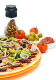 Pizza, tomatoes, olives and spices on a white background Royalty Free Stock Photo