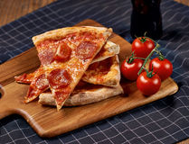 Pizza and tomatoes Stock Photography