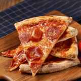 Pizza and tomatoes Royalty Free Stock Photography