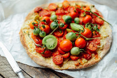 Pizza with tomatoes, shallot and fresh herbs. Cherry Tomato Wood Royalty Free Stock Image