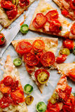 Pizza with tomatoes, shallot and fresh herbs. Cherry Tomato Wood Royalty Free Stock Photo