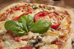 Pizza with tomatos. Pizza with tomato on brown paper Stock Photo