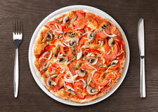 Pizza Top View On Plate With Fork And Knife Royalty Free Stock Photos
