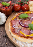 Pizza topped with Salami Royalty Free Stock Photos