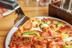 Pizza with topping  pork sausage, Italian sausage, pepperoni, ha. M, bacon,  mozzarella cheese,onion, capsicum, mushroom and pineapple Stock Photos