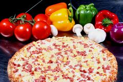 pizza with toppings stock photos