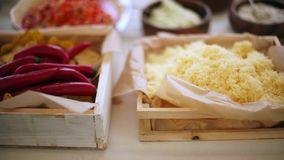Pizza toppings, grated cheese and pepper. stock video