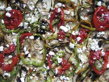 Pizza toppings. A pizza with red pepper, green pepper, and feta cheese Royalty Free Stock Image