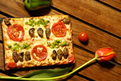 Pizza Tulip. Pizza open-faced baked pie of Italian origin, consisting of a thin layer of bread dough topped with spiced tomato sauce and cheese, often garnished Royalty Free Stock Photos