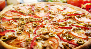 Pizza with tuna. Chicago pizza made from fresh cheese and selected vegetables, consisting of tuna and olives Royalty Free Stock Images