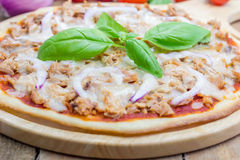 Pizza with tuna fish on a wooden board Stock Photography