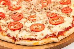 Pizza with tuna, mozzarella, tomatoes, tuna, onion stock images