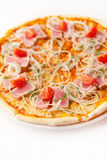Pizza with tuna, onion rings and cherry Stock Photography