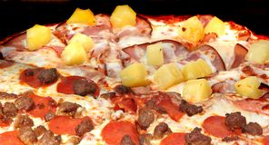 Pizza, two types. Pizza, half sausage and pepperoni, half ham and pineapple Stock Images