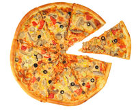 Pizza with the up cut off piece Royalty Free Stock Photos