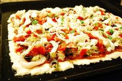 Pizza vóór baksel Stock Fotografie
