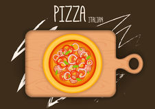 Pizza from a variety of ingredients on the kitchen board. Pizza from a variety of ingredients on the kitchen board Stock Images