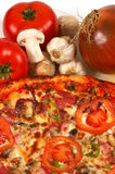 Pizza and vegetables. Italian pizza close up, and vegetables Royalty Free Stock Image
