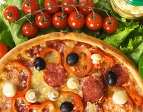 Pizza with vegetables and cherry tomatoes Stock Images