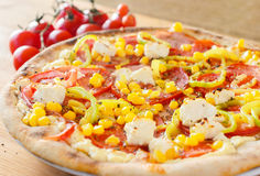 Pizza with vegetables, feta and ham Royalty Free Stock Photography
