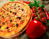 Pizza with vegetables and herbs Royalty Free Stock Image