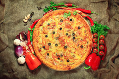 Pizza with vegetables and herbs rustic background Royalty Free Stock Photos
