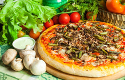Pizza and vegetables Stock Photo