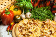 Pizza and vegetables Stock Photos