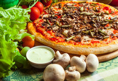 Pizza and vegetables Royalty Free Stock Photo