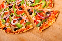 Pizza with vegetables and pepperoni Royalty Free Stock Images