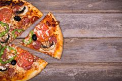 Pizza with vegetables and pepperoni Stock Images