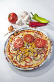 Pizza with vegetables on plate Royalty Free Stock Image