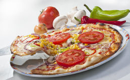 Pizza with vegetables on plate Stock Image