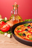 Pizza and vegetables on a red Royalty Free Stock Images