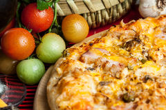 Pizza and vegetables Royalty Free Stock Images