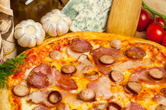 Pizza and vegetables Stock Images