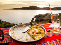 Pizza with a view over Lake Titicaca Royalty Free Stock Images