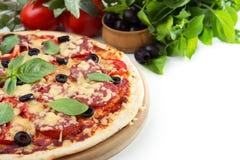 Pizza. On a white background Stock Photos