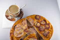 Pizza on a white background. Pizza with salami and coffee for breakfast Stock Photography