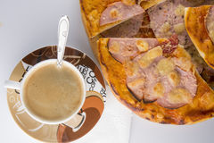 Pizza on a white background. Pizza with salami and coffee for breakfast Royalty Free Stock Photos