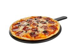 Pizza on white board isolated white royalty free stock photography