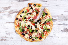 Pizza on white wooden background. Royalty Free Stock Photography