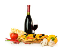 Pizza with wine and ingredients Stock Photo